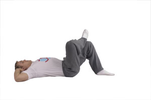Cross-Over Crunches with Ankle On Knee